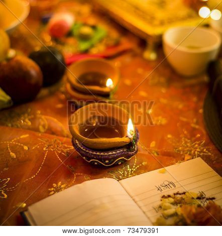 A lamp in a puja set up  for an Indian festival - Diwali