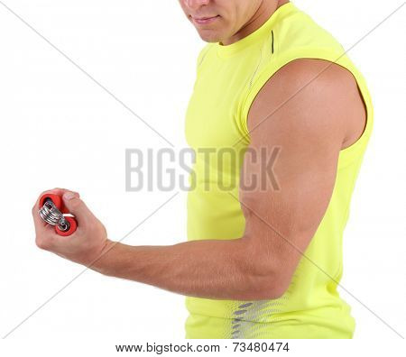 Young muscular sportsman execute exercise isolated on white