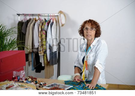 Middle-aged Dressmaker Working In His Workshop