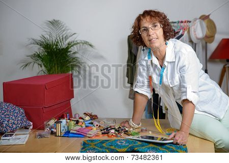 Middle-aged Dressmaker Working