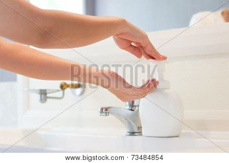 Hands Applying Sanitizer Soap
