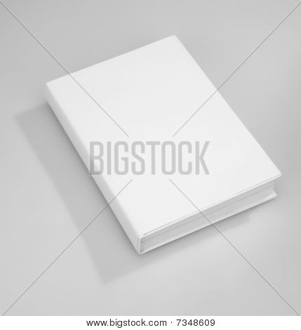 Single Blank book white cover on gray background