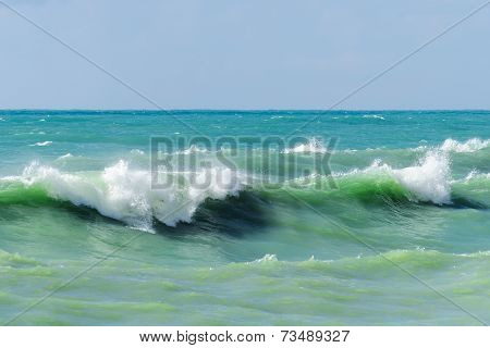 Storm waves on the sea shallows.