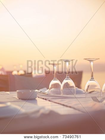 Beautiful table setting on the beach, beautiful crystal wine glasses for romantic wedding celebration, luxury event concept