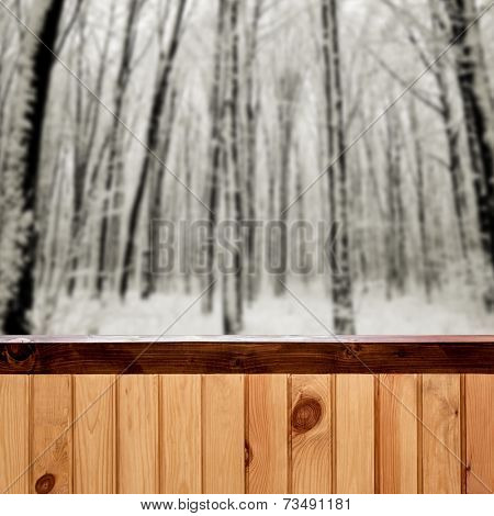 Christmas snow on the wood fence textured backgrounds. forest winter backgrounds