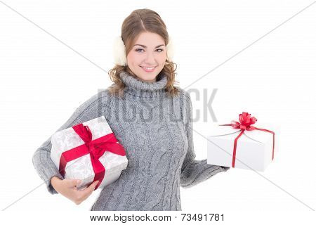 Happy Attractive Woman In Woolen Sweater And Muffs With Presents Isolated On White