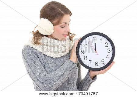 Happy Beautiful Woman In Winter Clothes With Office Clock Isolated On White