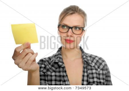 Beautiful  Blonde Student Girl With Glasses Takes A Yellow Note