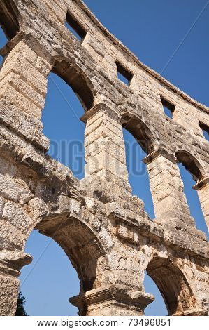 Wall Of The Ancient Amphitheater In The Sky In Pula. Croatia