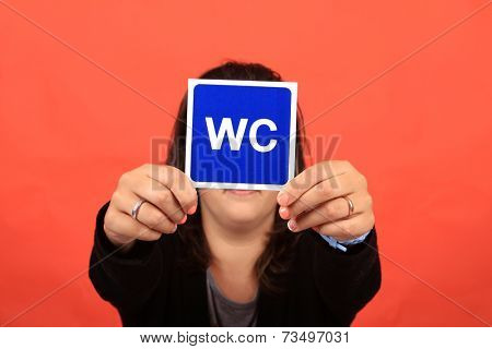 Woman with WC sign