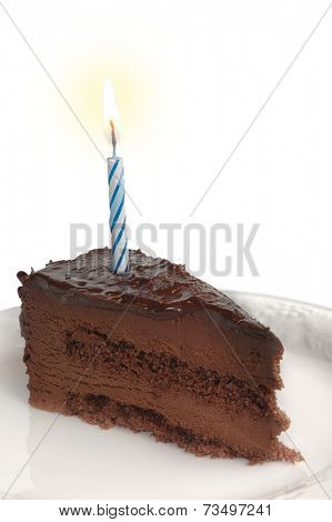 Birthday cake with burning candle studio isolated on white background