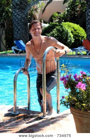 Handsome Middle Aged Man Climbing Out Of Swimming Pool Stock Photo Stock Images Bigstock