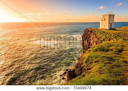 Lighthouse on Latrabjarg cliffs in Iceland