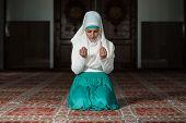 stock photo of tasbih  - Young Muslim Woman Praying In Mosque  - JPG