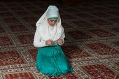 image of tasbih  - Young Muslim Woman Praying In Mosque  - JPG