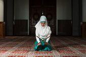 foto of tasbih  - Young Muslim Woman Praying In Mosque  - JPG