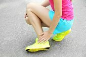 foto of sports injury  - Sports injuries of girl outdoors  - JPG