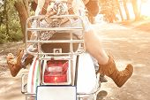 stock photo of dirt-bike  - Young attractive couple traveling by scooter along dirt road  - JPG