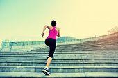 pic of ponytail  - Runner athlete running on city stairs - JPG