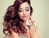 foto of silver-hair  - Beautiful model with long curly hair and silver nails - JPG