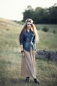 foto of hippy  - Beautiful hippie girl on nature. Boho fashion style
