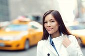 stock photo of cabs  - Young urban professional business woman in New York City Manhattan - JPG