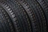 stock photo of four-wheel drive  - black summer tires close up studio shot - JPG