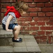 image of stairway  - cute little girl walks by the stairway - JPG