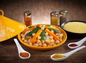 picture of tagine  - Vegetable tagine with cous cous and spices on wooden table - JPG