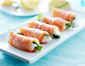 stock photo of cheese platter  - smoked salmon and arugul warp with cream cheese on platter - JPG