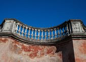 foto of balustrade  - Fragment of old rustic pink wall with balustrade - JPG