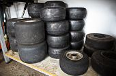 stock photo of karts  - Loads of Karts wheels and tires after competition - JPG