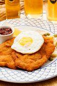 stock photo of wieners  - Wiener Schnitzel with egg - JPG