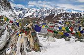 foto of cho-cho  - Prayer flags in the mountains. Cho La Pass. Himalayas. Nepal