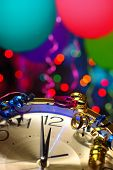 pic of midnight  - New year party decoration with balloons and clock close to midnight - JPG