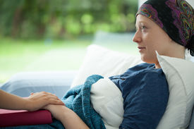 stock photo of chemotherapy  - Cancer woman lying in bed supported by mum - JPG