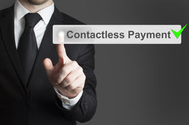 foto of payment methods  - businessman in black suit pushing virtual button contactless payment checked - JPG