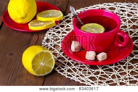 Tea With A Lemon In A Red Mug