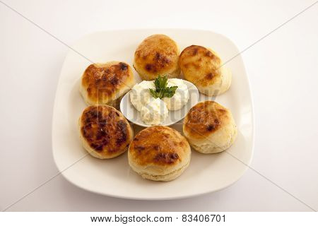 bun on food plate with bread and cheese