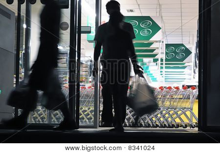 Shoppers Exiting Grocery Store (blurred Motion)