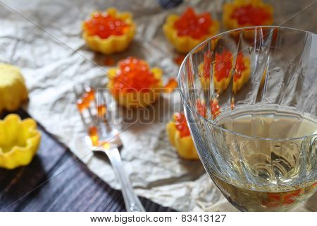 Glass Of Wine And Tartlet With Red Caviar