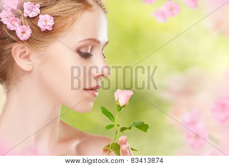 Beauty Face Of Young Beautiful Woman With Pink Flowers In Her Hair