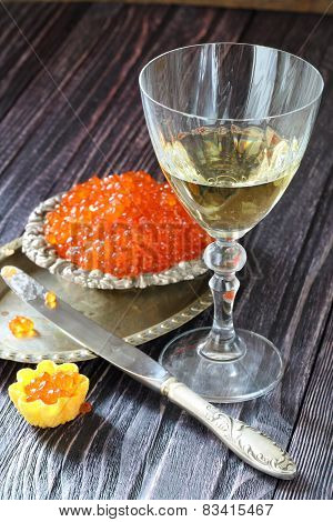 White Wine And Tartlet With Red Caviar
