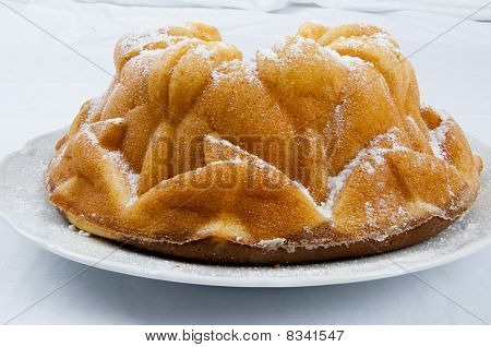 Decorated Marble Cake On Plate On White Background