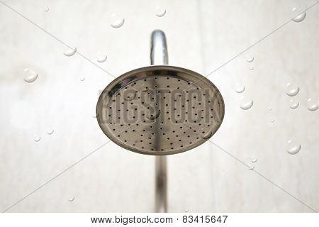 Silver Shower Head with Drops of water  in the Bathroom