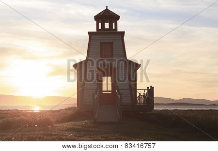 A beautiful lighthouse on a sunset background
