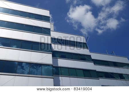 Business Building With Blue Sky On The Reflection Glass