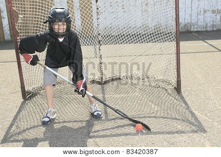 A Portrait of hockey ball player with hockey stick