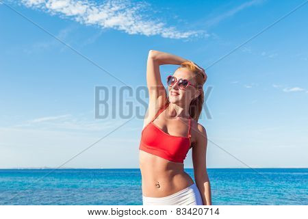 Cheerful young woman at the sea