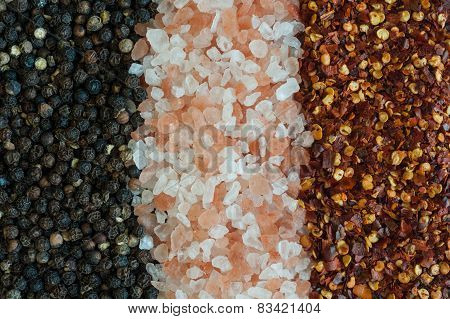 salt, pepper and chili pepper flakes background
